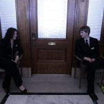 These two were seated outside the room where the Democratic Caucus was meeting.