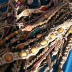 Most vendors peddled handmade goods like these hemp necklaces.